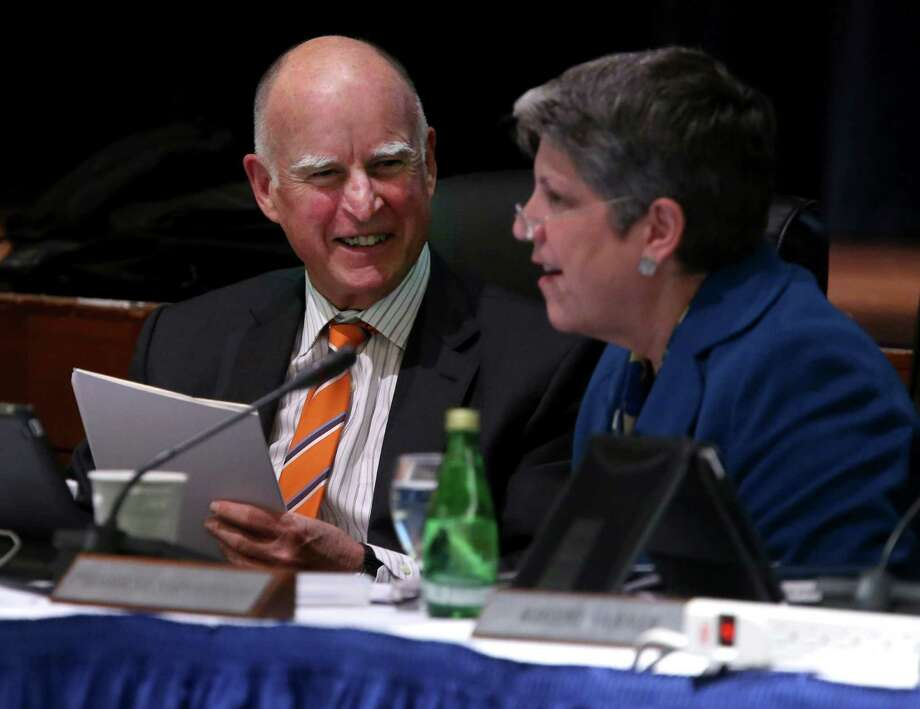 Gov. Jerry Brown and UC President Janet Napolitano smile after updating the University of California Board of Regents on their ongoing discussions about proposed tuition increases in San Francisco, Calif. on Wednesday, March 18, 2015. Photo: Paul Chinn / The Chronicle / ONLINE_YES