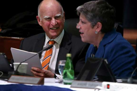 Gov. Jerry Brown and UC President Janet Napolitano smile after updating the University of California Board of Regents on their ongoing discussions about proposed tuition increases in San Francisco, Calif. on Wednesday, March 18, 2015.
