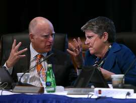 Gov. Jerry Brown and University of California President Janet Napolitano confer before discussing proposed tuition hikes during the UC Board of Regents meeting at the UCSF Mission Bay campus in San Francisco, Calif. on Wednesday, March 18, 2015.