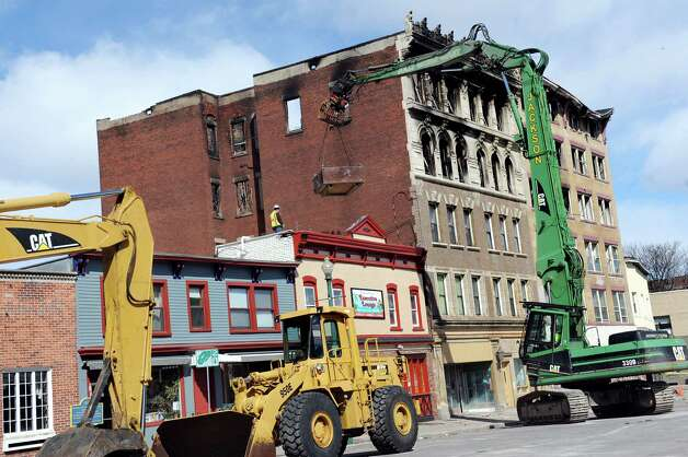 Jackson Demolition places hay bales on the roofs of neighboring structures as they prepare for upcoming demolition of the Jay Street apartment buildings on Wednesday, March 18, 2015, in Schenectady, N.Y. (Cindy Schultz / Times Union) Photo: Cindy Schultz / 10031086A