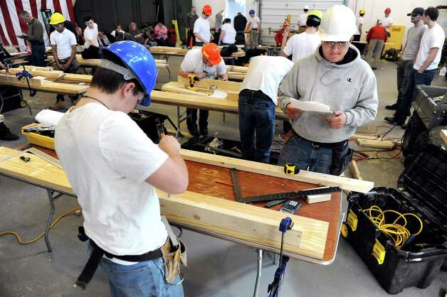 BOCES high school students show their carpentry skills during the annual SkillsUSA competition on Wednesday, March 18, 2015, at Stratton Air National Guard Base in Scotia, N.Y. High school students tested their skills including heavy equipment operation, heating equipment repair and nursing. (Cindy Schultz / Times Union) Photo: Cindy Schultz / 00031074A