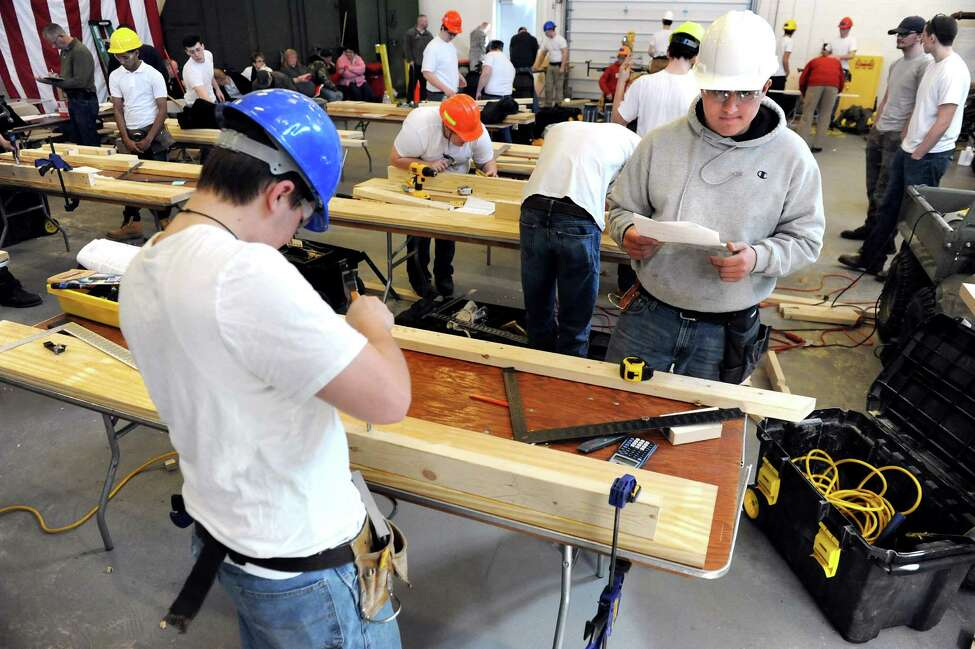 Click through the slideshow to see how much tradespeople in the Albany-Schenectady-Troy area earn. The 2018 information is from the U.S. Bureau of Labor and Statistics. BOCES high school students show their carpentry skills during the annual SkillsUSA competition on Wednesday, March 18, 2015, at Stratton Air National Guard Base in Scotia, N.Y. High school students tested their skills including heavy equipment operation, heating equipment repair and nursing. (Cindy Schultz / Times Union)