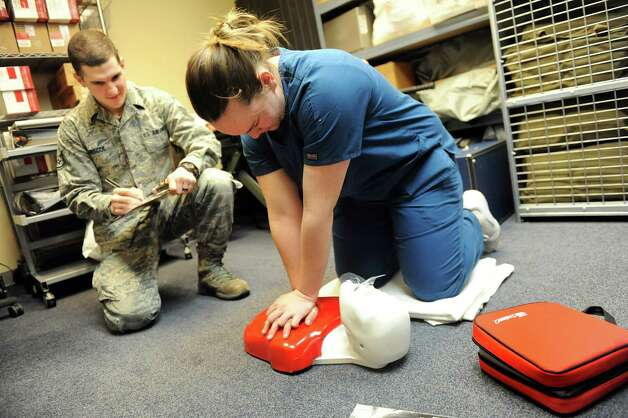 McKayla Monty, 17, right, performs CPR as Staff Sgt. Tyler Briscoe judges her for the nursing procedures during the annual SkillsUSA competition on Wednesday, March 18, 2015, at Stratton Air National Guard Base in Scotia, N.Y. BOCES high school students tested their skills including heavy equipment operation, heating equipment repair and carpentry. (Cindy Schultz / Times Union) Photo: Cindy Schultz / 00031074A