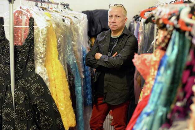 Local designer Daniel Mozzes with his dresses for an upcoming fashion show to benefit the Leukumia/Lymphoma Society in his Pearl Street studio Wednesday March 18, 2015 in Albany, NY.  (John Carl D'Annibale / Times Union) Photo: John Carl D'Annibale / 00030930A