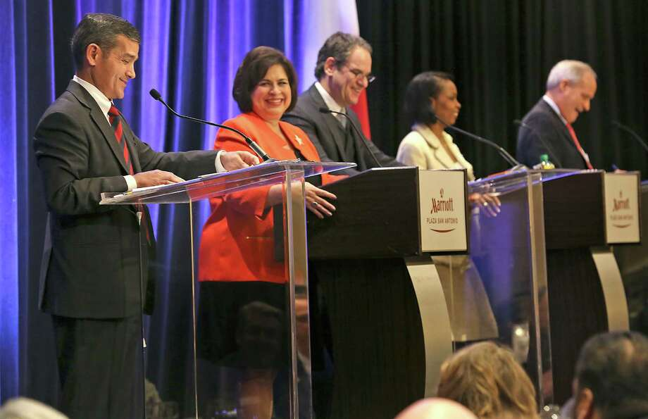 Mayoral candidates from right, County Commissioner Tommy Adkisson, Mayor Ivy Taylor, Senator Leticia Van de Putte and Representative Mike Villarreal enjoy a light moment with Moderator Scott Joslove, center, during the Hospitality Industry San Antonio Mayoral Debate at Marriott Plaza San Antonio, Wednesday, March 18, 2015. Photo: Bob Owen, Staff / San Antonio Express-News / ©2015 San Antonio Express-News
