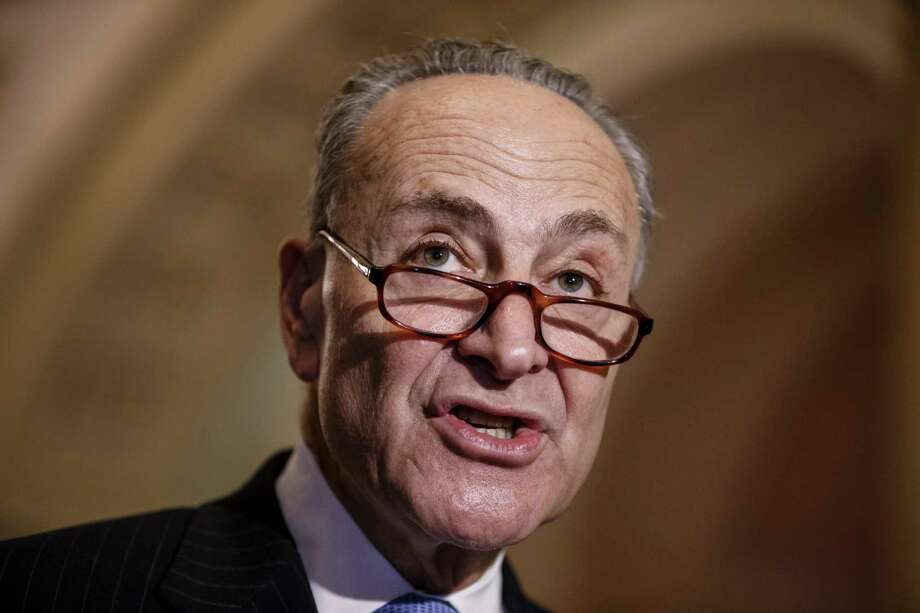 Sen. Chuck Schumer, D-N.Y., and Democratic leaders meet with reporters after Republicans gave up on their quest to stop funding for the Homeland Security Department unless it contained roll backs to counter President Barack Obama's executive actions on immigration, at the Capitol in Washington, Tuesday, March 3, 2015. (AP Photo/J. Scott Applewhite) ORG XMIT: DCSA133 Photo: J. Scott Applewhite / AP