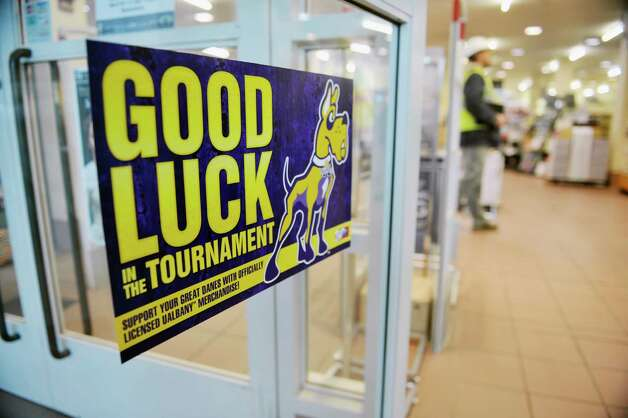 A poster is seen on the door to the University at Albany bookstore on Wednesday, March 18, 2015, in Albany, N.Y.  Both the men's and women's basketball teams are playing in the NCAA tournament.  (Paul Buckowski / Times Union) Photo: PAUL BUCKOWSKI / 00031071A