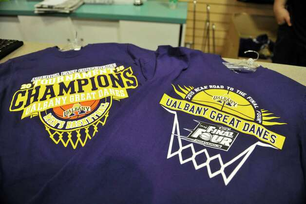T-shirts are seen on display at the University at Albany bookstore on Wednesday, March 18, 2015, in Albany, N.Y.  Both the men's and women's basketball teams are playing in the NCAA tournament.  (Paul Buckowski / Times Union) Photo: PAUL BUCKOWSKI / 00031071A