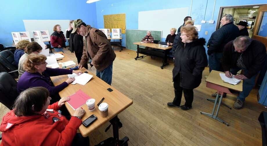 Voters check-in with election officials at the Stillwater Community Center where ballots were cast in village elections Wednesday afternoon, March 18, 2015, in Stillwater, N.Y.  (Skip Dickstein/Times Union) Photo: SKIP DICKSTEIN / 00031044A