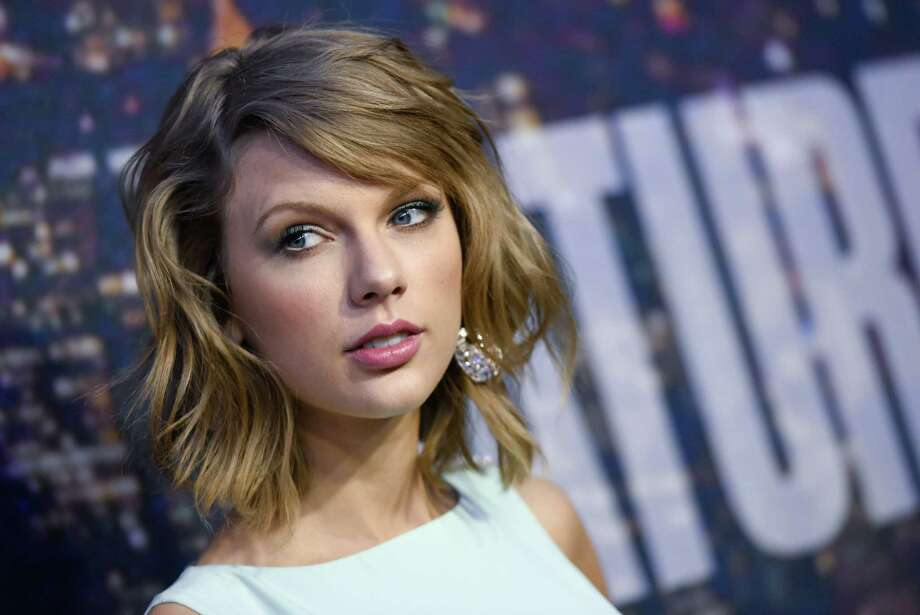 """FILE - In this Feb. 15, 2015 file photo, singer Taylor Swift attends the SNL 40th Anniversary Special in New York. The governor of Rhode Island is defending a proposed luxury tax for pricey second homes that has been dubbed the """"Taylor Swift tax."""" Gov. Gina Raimondo says she wants to raise nearly $12 million by implementing a statewide property tax on second homes worth more than $1 million. Swift has a beachfront mansion in Westerly, Rhode Island. (Photo by Evan Agostini/Invision/AP, File) ORG XMIT: NYET350 Photo: Evan Agostini / Invision"""
