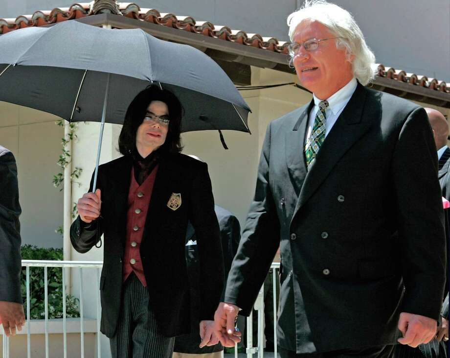 FILE - In this May 20, 2005 file photo, Michael Jackson, left, and lead defense attorney Thomas Mesereau Jr. leave Jackson's child molestation trial at the Santa Barbara County Courthouse in Santa Maria, Calif. The whispered words of real estate heir Robert Durst recorded in an unguarded moment in a bathroom could come back to haunt him -  or help him - as he faces a murder charge. A possible move by prosecutors to introduce the incriminating material from a six-part documentary on his strange life and connection to three killings could back fire as interview footage did in the Jackson molestation trial and the Robert Blake murder case. (AP Photo/ Damian Dovarganes, File) Photo: Damian Dovarganes, STF / Associated Press / AP
