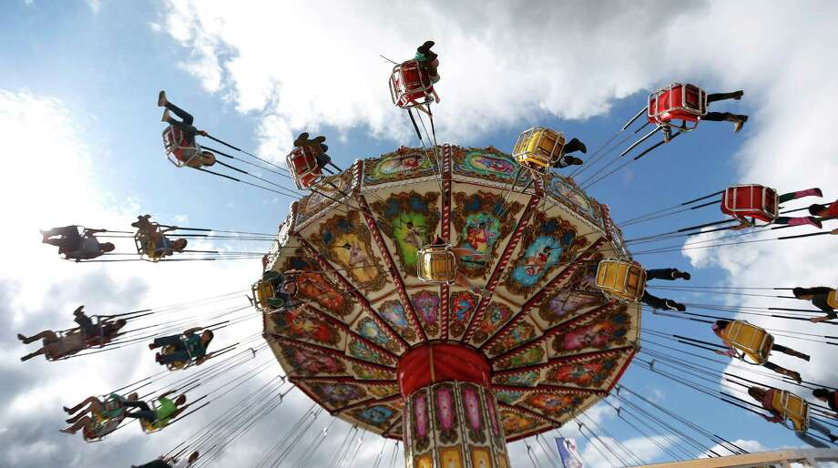Rodeo visitors spin around on the Big Top ride during the Houston Livestock Show and Rodeo at NRG Park, Wednesday, March 18, 2015, in Houston. Photo: Karen Warren, Houston Chronicle / © 2015 Houston Chronicle