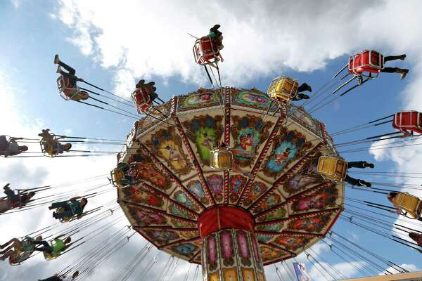 Rodeo visitors spin around on the Big Top ride during the Houston Livestock Show and Rodeo at NRG Park, Wednesday, March 18, 2015, in Houston.