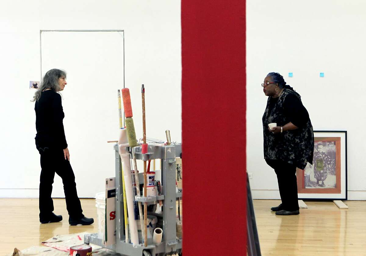 Richmond Art Center's Jan Langdon (left) and Bay Area artist Mildred Howard are at the art center to uncrate and prepare for Howard's art show later this month, pictured Friday, March 13, 2015, in Richmond, Calif.