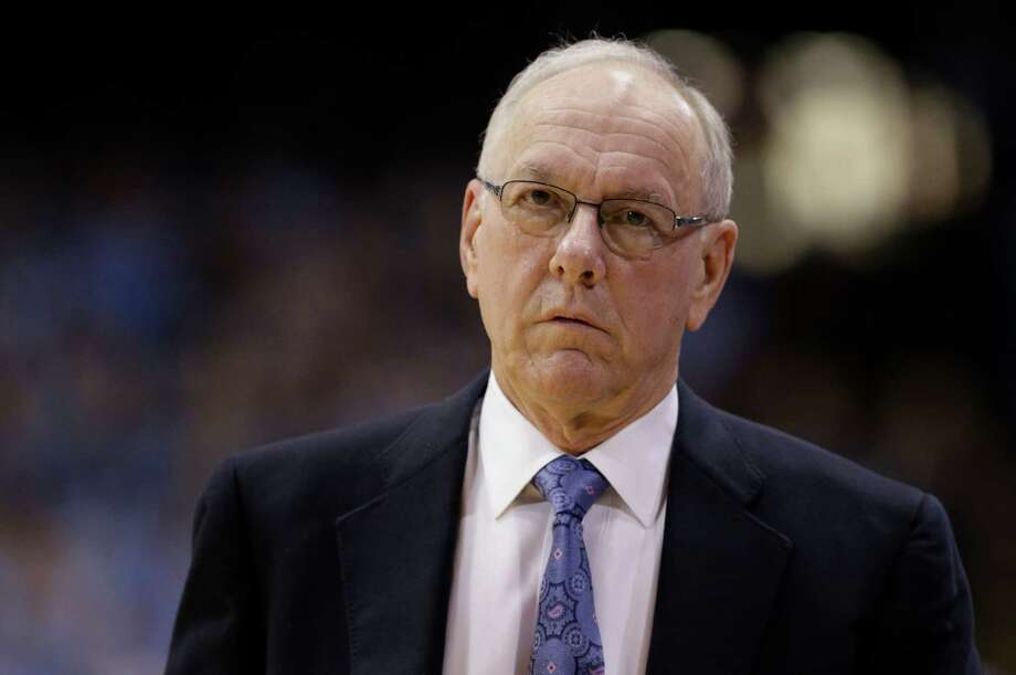 "FILE - In this Jan. 26, 2015, file photo, Syracuse coach Jim Boeheim walks along the sidelines during the first half of an NCAA college basketball game against North Carolina in Chapel Hill, N.C. Syracuse university officials say coach Boeheim will retire in three years and athletic director Daryl Gross has resigned following punishment from the NCAA for violations that lasted more than a decade. Chancellor Kent Syverud said Wednesday, March 18, 2015, that Boeheim, a Hall of Famer and head coach for 39 years, decided to make the announcement to ""bring certainty to the team and program in the coming years"" and to allow for a smooth transition.  (AP Photo/Gerry Broome, File) ORG XMIT: NY167 Photo: Gerry Broome / AP"