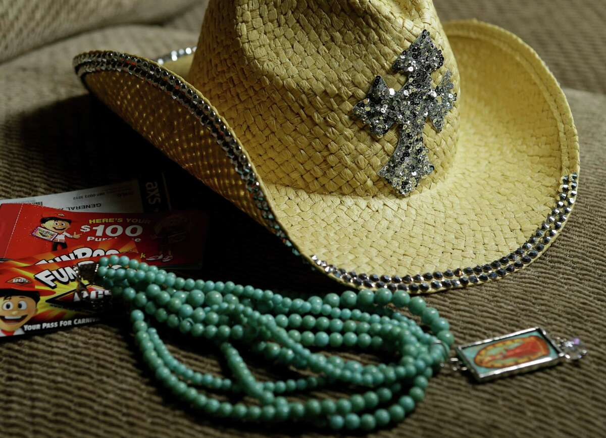A hat, necklace and $100.00 in carnival passes are shown Wednesday, March 18, 2015, in La Porte that were purchases made by the Cody family of La Porte during their visit to the Houston Livestock Show and Rodeo. John Cody, his wife, Maricruz Cody, and their children, Abigail, 15, Celeste, 11, and Sarah, 8, were detained and questioned during their visit to the Houston Livestock Show and Rodeo for allegedly shoplifting.