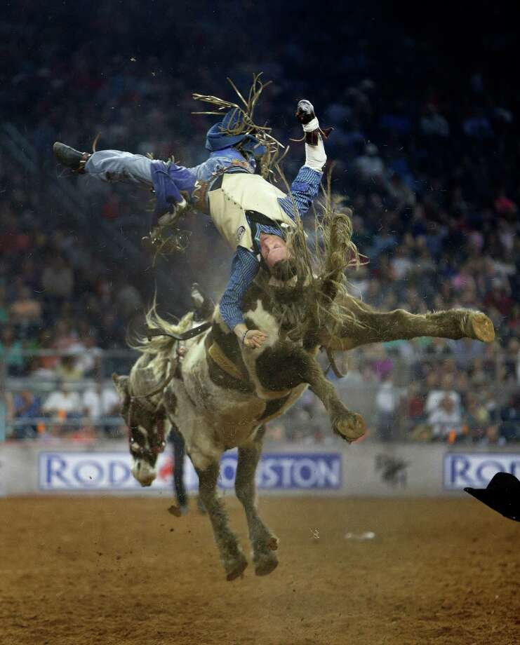 Orin Larsen loses control during the bareback riding competition Wednesday night. Photo: Karen Warren, Staff / © 2015 Houston Chronicle