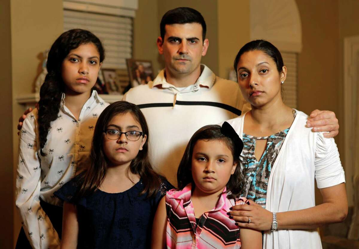 John Cody, center, his wife, Maricruz and their children, Abigail, 15, left, Celeste, 11, and Sarah, 8, came from their home in La Porte to the rodeo. The family was detained and questioned about shoplifting, then later cleared.