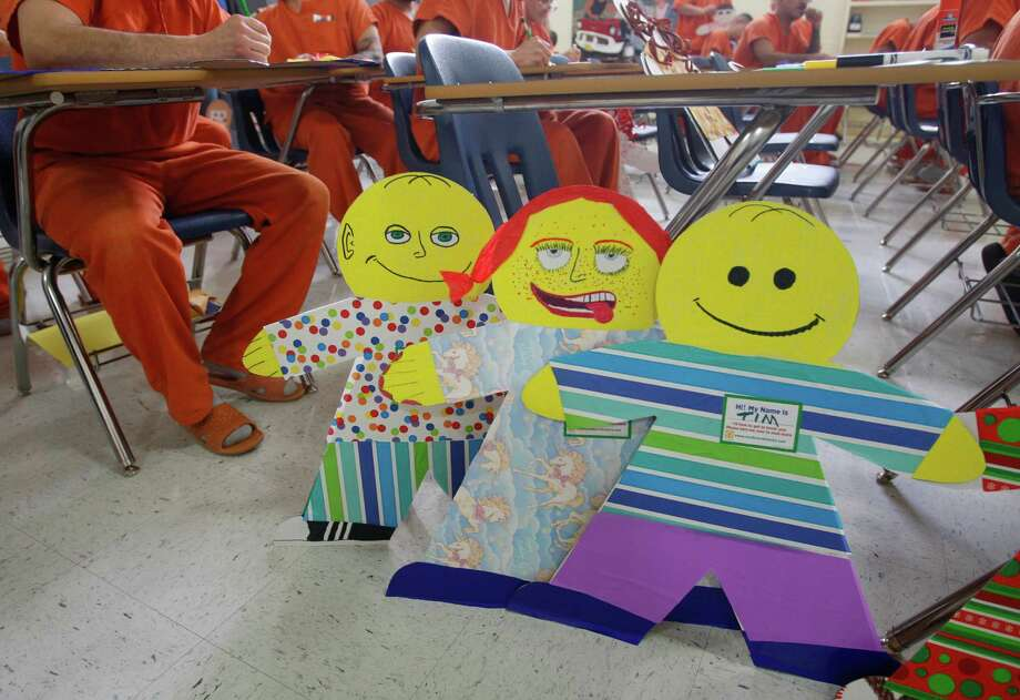 These Cardboard Kids were decorated by mail inmates at the Bexar County Jail. The images are meant to represent cases of child abuse and neglect that occur each year.  are seen Wednesday March 18, 2015. Part of a child abuse prevention program started last year by ChildSafe, the Cardboard Kids are meant to represent the thousands of confirmed and countless unreported abuse cases that happen in Bexar County each year, according to ChildSafe. ChildSafe reported there were 5434 confirmed cases of child abuse and neglect in Bexar County in 2014. April is National Child Abuse Awareness Month. Photo: William Luther /San Antonio Express-News / ©2015 San Antonio Express-News