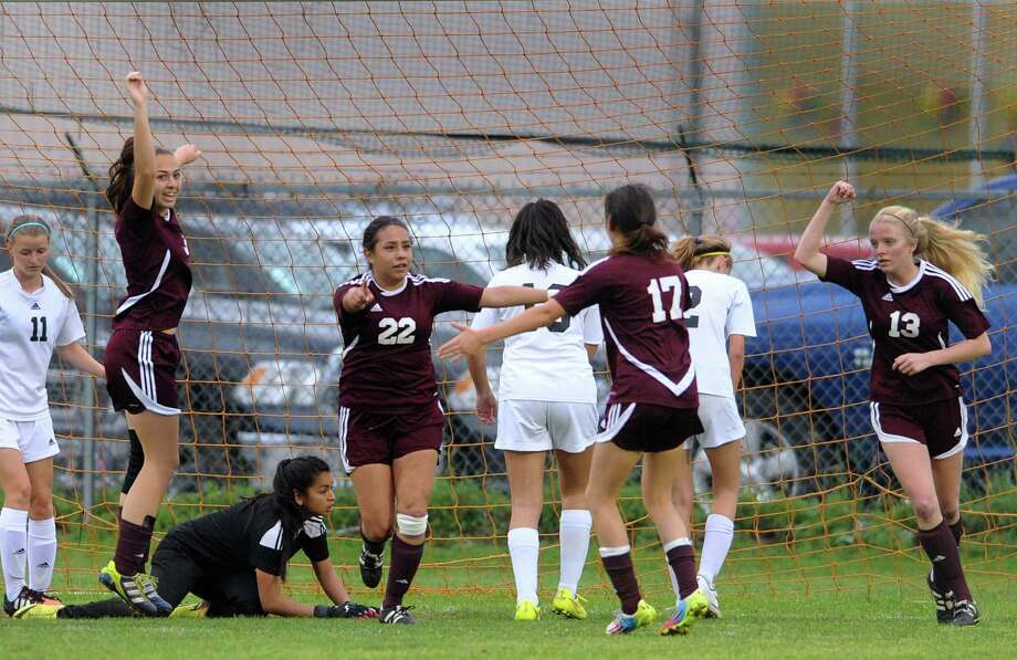 Marshall girls soccer team members celebrate after Kristen Paredes (22) scored a first-half goal during District 27-6A girls soccer action at the Northside ISD complex on Wednesday, March 18, 2015. Photo: San Antonio Express-News / San Antonio Express-News