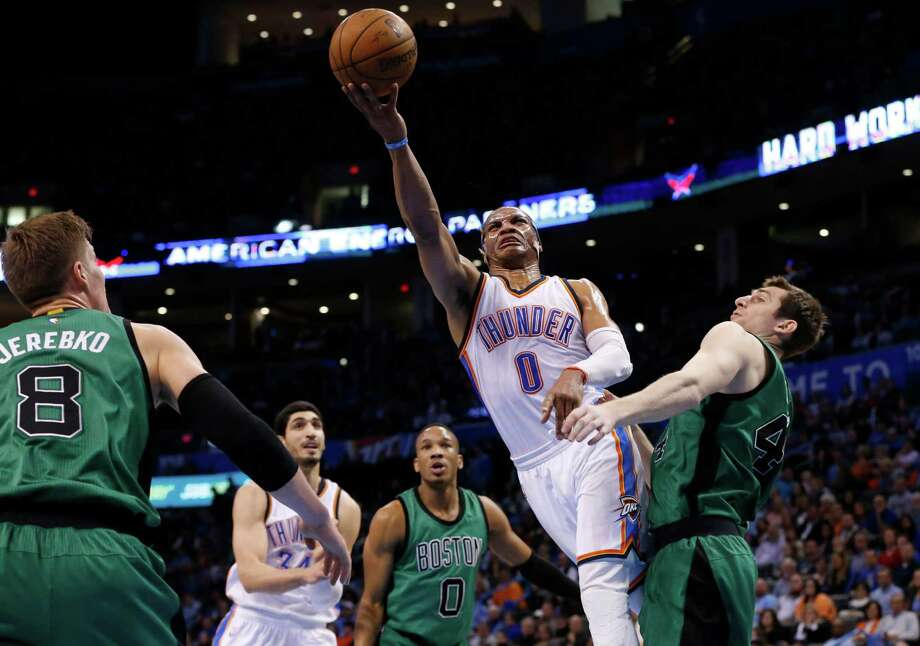 Oklahoma City Thunder guard Russell Westbrook (0) shoots between Boston Celtics forward Jonas Jerebko (8) and center Tyler Zeller (44) in the second quarter of an NBA basketball game in Oklahoma City, Wednesday, March 18, 2015. (AP Photo/Sue Ogrocki) ORG XMIT: OKSO108 Photo: Sue Ogrocki / AP