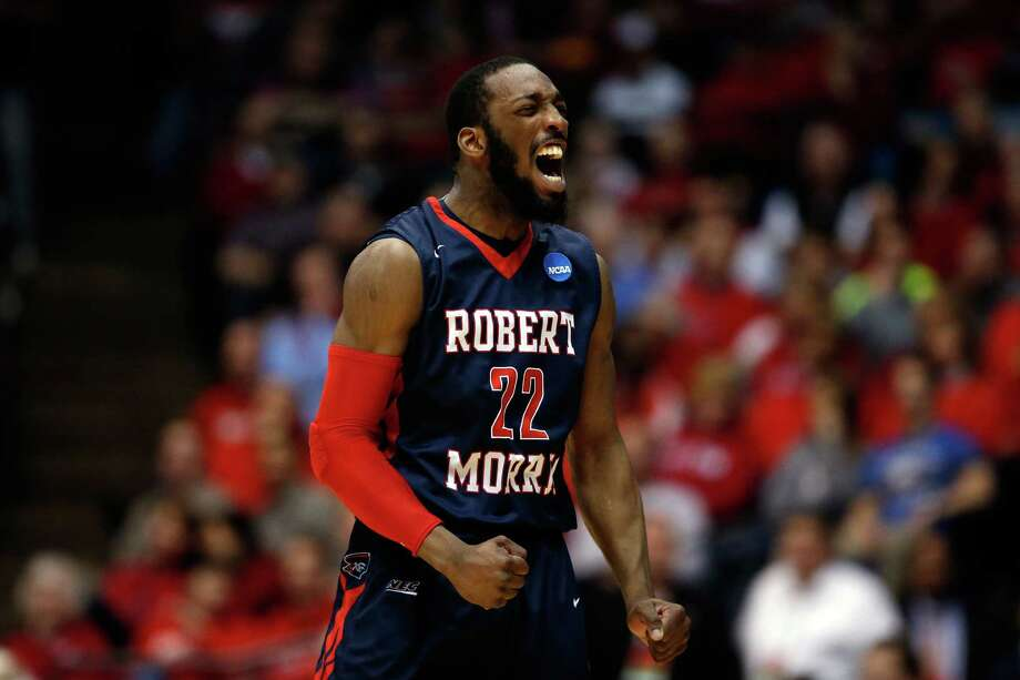 DAYTON, OH - MARCH 18:  Lucky Jones #22 of the Robert Morris Colonials celebrates against the North Florida Ospreys during the first round of the 2015 NCAA Men's Basketball Tournament at UD Arena on March 18, 2015 in Dayton, Ohio.  (Photo by Gregory Shamus/Getty Images) ORG XMIT: 527065345 Photo: Gregory Shamus / 2015 Getty Images