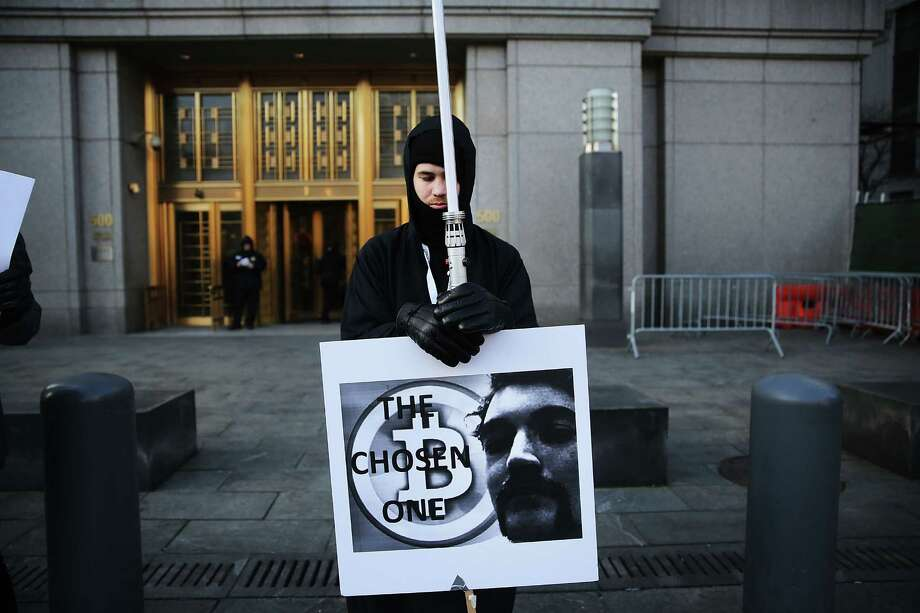Max Dickstein stands with other supporters of Ross Ulbricht, the creator and operator of the Silk Road underground market, in front of a Manhattan federal court house on the first day of jury selection for his trial on Jan. 13, 2015 in New York City.  Ulbricht was convicted of drug crimes after making millions of dollars from the Silk Road website which sold drugs and other illegal commodities anonymously. Photo: Spencer Platt, Getty Images / 2015 Getty Images