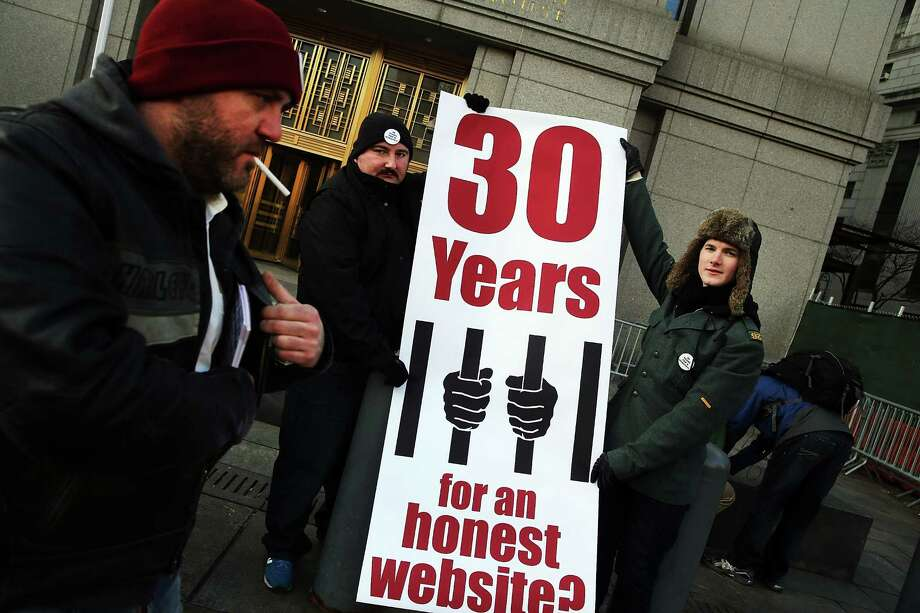 Supporters of Ross Ulbricht, the alleged creator and operator of the Silk Road underground market, stand in front of a Manhattan federal court house on the first day of jury selection for his trial on January 13, 2015 in New York City.  Ulbricht, who has pleaded not guilty, is accused by the US government of making millions of dollars from the Silk Road website which sold drugs and other illegal commodities anonymously. Photo: Spencer Platt, Getty Images / 2015 Getty Images