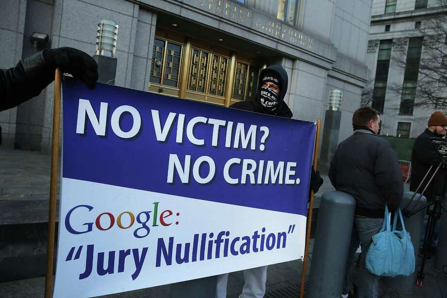 NEW YORK, NY - JANUARY 13:  Supporters of Ross Ulbricht, the alleged creator and operator of the Silk Road underground market, stand in front of a Manhattan federal court house on the first day of jury selection for his trial on January 13, 2015 in New York City.  Ulbricht, who has pleaded not guilty, is accused by the US government of making millions of dollars from the Silk Road website which sold drugs and other illegal commodities anonymously. Photo: Spencer Platt, Getty Images / 2015 Getty Images