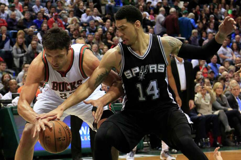 Milwaukee Bucks center Zaza Pachulia, left, and San Antonio Spurs guard Danny Green, right, fight for the ball during the first half of an NBA basketball game Wednesday, March 18, 2015, in Milwaukee. (AP Photo/Darren Hauck) Photo: Darren Hauck, FRE / Associated Press / FR81528 AP