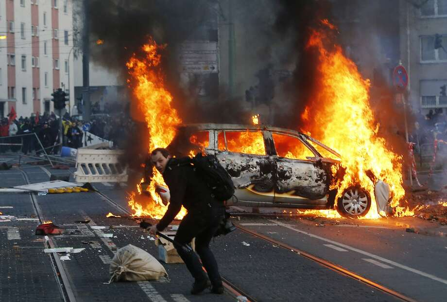 A police car burns after clashes between demonstrators and police Wednesday, March 18, 2015 in Frankfurt, Germany. The Blockupy alliance said activists plan to try to blockade the new headquarters of the ECB to protest against government austerity and capitalism. Photo: Michael Probst, Associated Press
