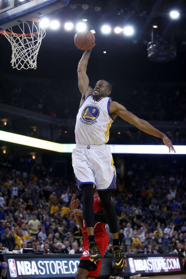 Andre Iguodala flies high for a fourth quarter dunk that put the Warriors ahead 90-66. Photo: Scott Strazzante, The Chronicle