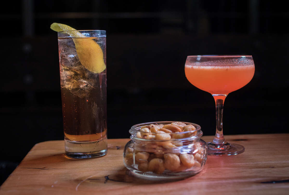 The Rye & Apple (left) and Victor & Nancy (each $10), with corn nuts, clockwise from above, at Harper & Rye on Polk Street in S.F.