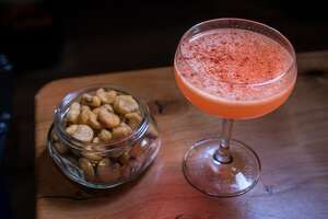 "The ""Victor & Nancy"" cocktail with Corn Nuts at Harper & Rye in San Francisco, Calif., is seen on Saturday, March 14th,  2015."