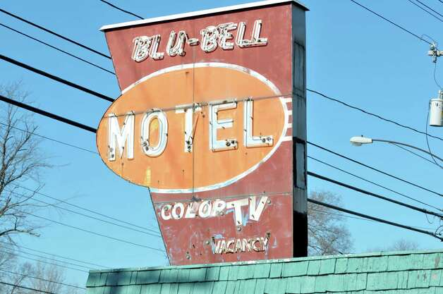 A view of the sign at the Blu-Bell Motel on Central Ave. on Thursday, Jan. 30, 2014, in Colonie, NY.  Thursday morning Colonie Police along with building inspectors executed a search warrant at the motel for violations.    (Paul Buckowski / Times Union archive) Photo: Paul Buckowski / 00025564A