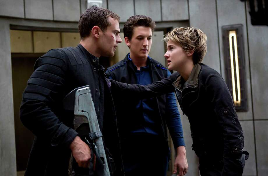 "Theo James, left, Miles Teller and Shailene Woodley star in ""Insurgent,"" the latest installment in the ""Divergent"" series. Photo: Andrew Cooper"