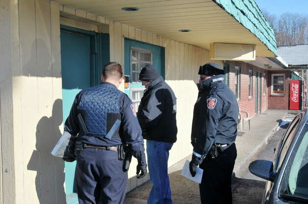 Colonie Police knock on the door of a room as they  execute a search warrant at the Blu-Bell Motel on Central Ave. on Thursday, Jan. 30, 2014 in Colonie, NY.   (Paul Buckowski / Times Union archive) Photo: Paul Buckowski / 00025564A