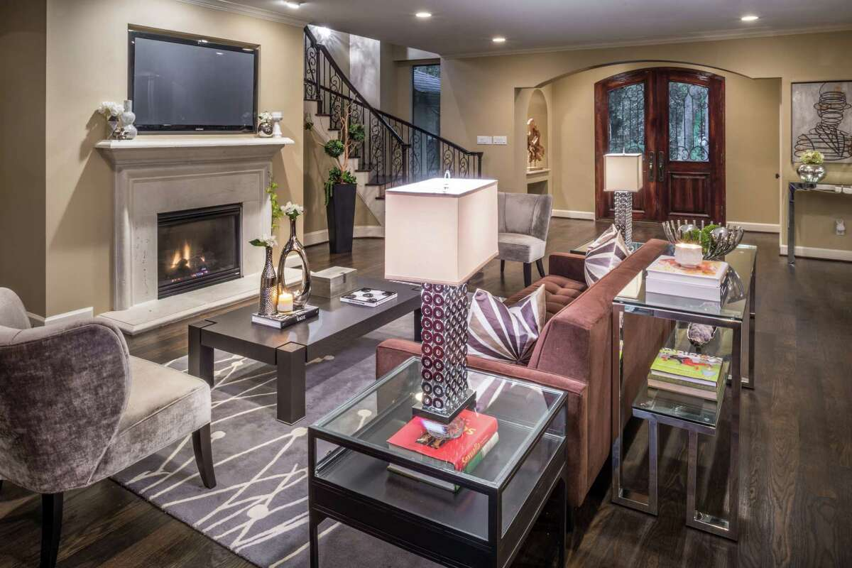 The Dikmens liked the open living room and kitchen, which form the core of the house. They darkened the floors and replaced the fireplace for a more contemporary/transitional look.