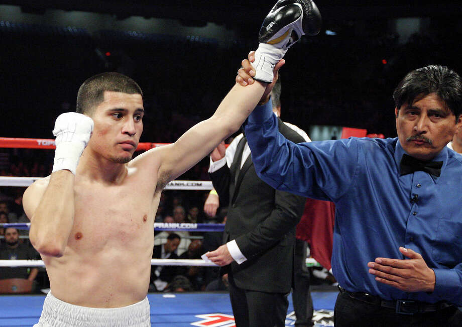 Adam Lopez (left) celebrates after his bantamweight fight with Richard Hernandez Feb. 4, 2012 at the Alamodome. Lopez won by TKO in the first round. Photo: Edward A. Ornelas /San Antonio Express-News / © SAN ANTONIO EXPRESS-NEWS (NFS)