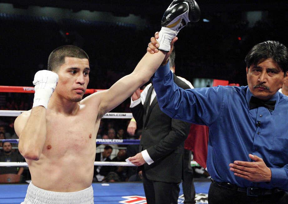 Adam Lopez (left) celebrates after his bantamweight fight with Richard Hernandez Feb. 4, 2012 at the Alamodome. Lopez won by TKO in the first round. Photo: Edward A. Ornelas /San Antonio Express-News / © SAN ANTONIO EXPRESS-NEWS (NFS)