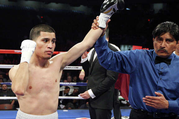 Adam Lopez (left) celebrates after his bantamweight fight with Richard Hernandez Feb. 4, 2012 at the Alamodome. Lopez won by TKO in the first round.