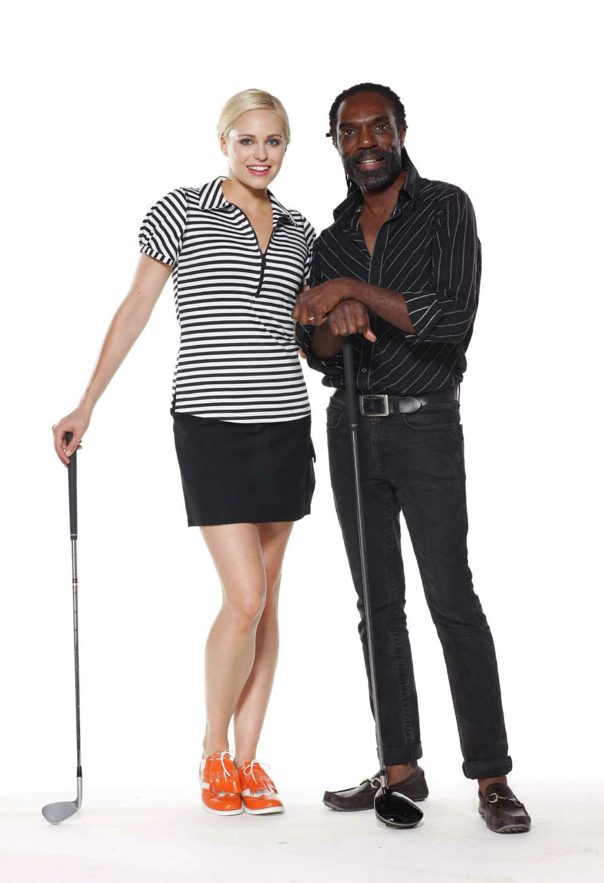 Los Angeles-based fashion designer Kevan Hall, right, poses with a model showing off some of the looks of his Keven Hall Sport line which began in 2014 with an active lifestyle brand of golf wear for women.
