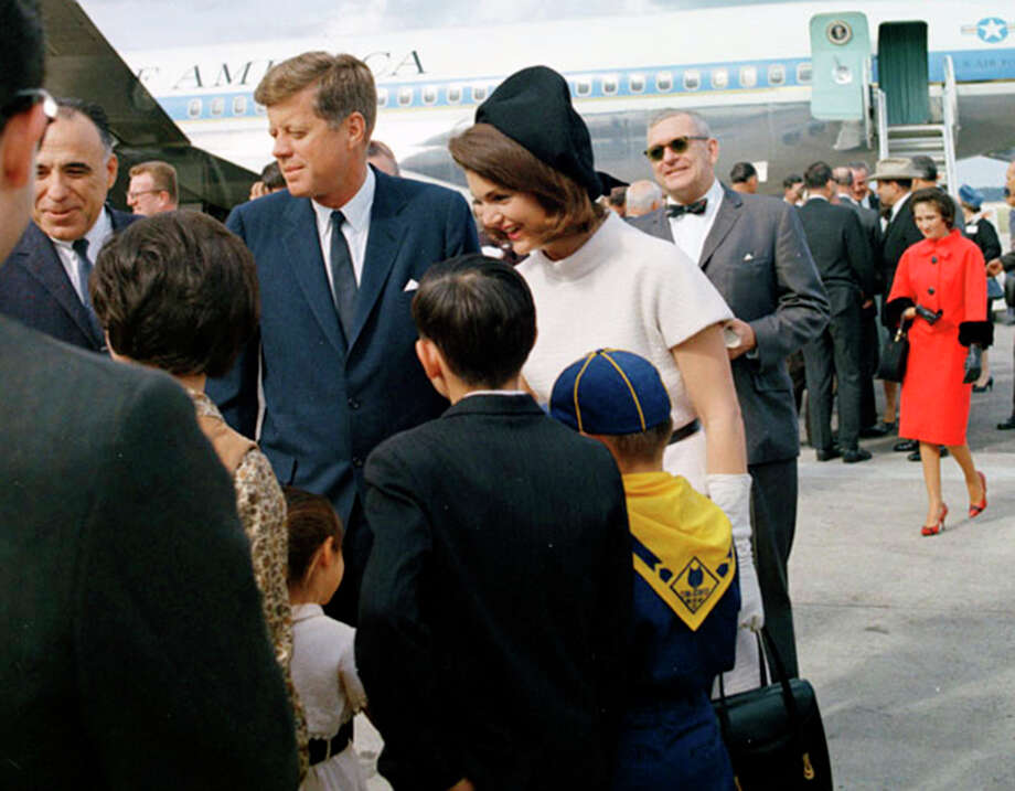 U.S. Congressman Henry B. Gonzalez, four of his children and wife Bertha (walking up behind them) were on hand when the Kennedys arrived Nov. 21, 1963, at San Antonio International Airport. Photo: Cecil Stoughton /JFK Presidential Library And Museum, Boston
