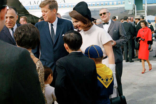 U.S. Congressman Henry B. Gonzalez, four of his children and wife Bertha (walking up behind them) were on hand when the Kennedys arrived Nov. 21, 1963, at San Antonio International Airport.