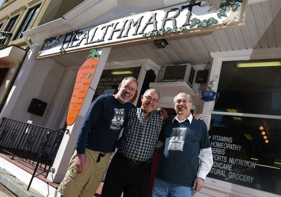 Business owner Chuck Ringel, center, stands with longtime employees Herb Young Jr., left, and his brother Rick Ringel outside Greenwich Health Mart in downtown Greenwich, Conn. Thursday, March 19, 2015.  After 28 years of ownership, Chuck and Carole Ringel have decided to call it quits and retire from their business - one of the last true mom and pop shops on Greenwich Avenue. Photo: Tyler Sizemore / Greenwich Time