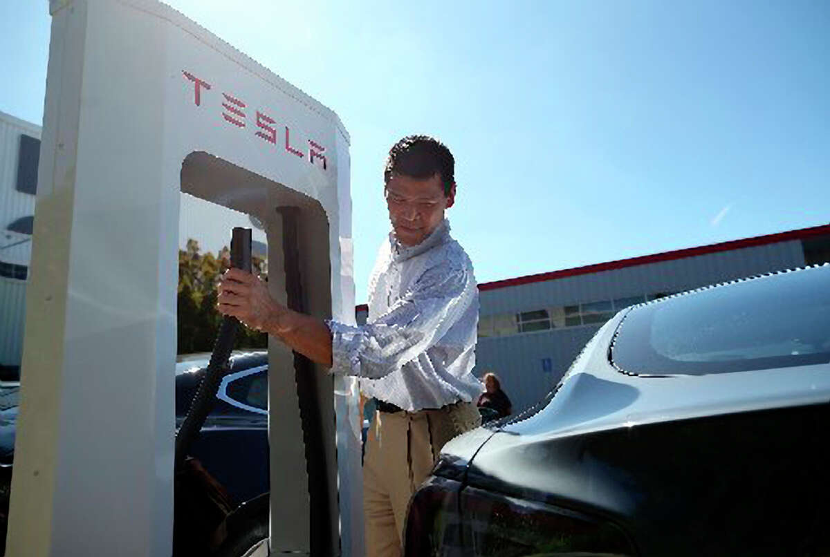 Tesla's high-speed Supercharger stations, including this one outside its Fremont factory, can be found with the upgrade. So can slower chargers.