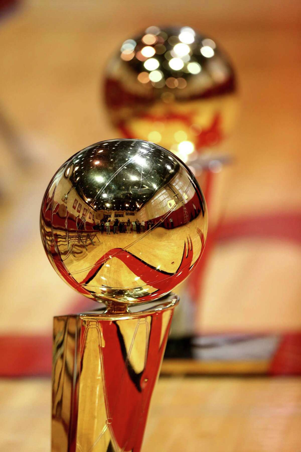 The NBA Championship trophies at a photo shoot honoring the Houston Rockets 20th anniversary of the 1993-94 and 1994-95 NBA back-to-back champion teams at the Toyota Center Thursday, March 19, 2015, in Houston, Texas.