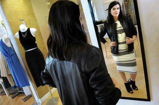 Circles saleswoman and denim buyer models Elizabeth and James separates, Vince leather jacket, Vince booties and Chan Luu Necklace on Wednesday, March 11, 2015, at Stuyvesant Plaza in Albany, N.Y. (Cindy Schultz / Times Union) Photo: Cindy Schultz / 00030922A