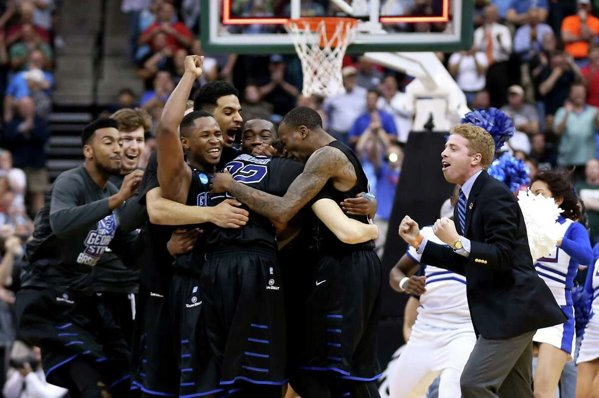 The Georgia State Panthers celebrate after the Panthers win 57-56 against the Baylor Bears in the second round of the 2015 NCAA Men's Basketball Tournament at Jacksonville Veterans Memorial Arena on March 19, 2015 in Jacksonville, Florida. (Photo by Mike Ehrmann/Getty Images)