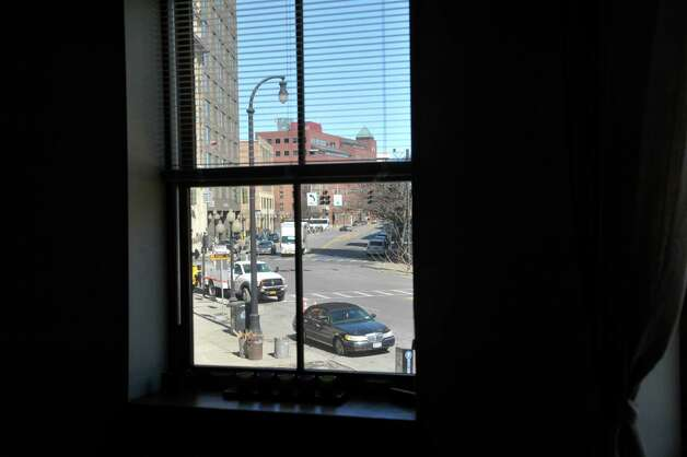 A view looking out onto Broadway inside a two bedroom, one bath, second floor apartment in the Argus Building at 412 Broadway on Thursday, March 12, 2015, in Albany, N.Y.   (Paul Buckowski / Times Union) Photo: PAUL BUCKOWSKI / 00030983A
